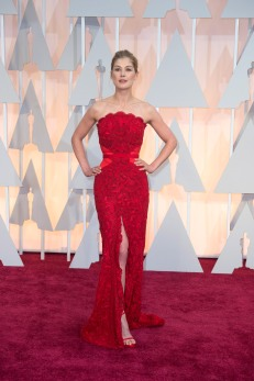 Rosamund Pike in a attention grabbing red Givenchy dress as she arrives at the 87th Annual Academy Awards