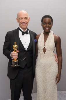 J.K. Simmons poses backstage with presenter and actress Lupita Nyong'o with his Oscar for Best Supporting Actor