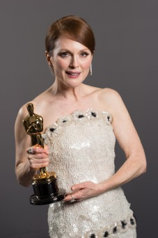 Julianne Moore holding her Oscar for Best Actress backstage