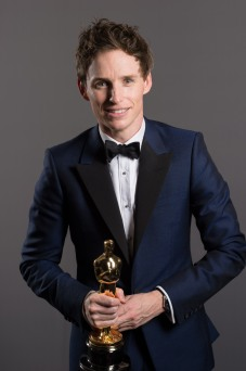 Eddie Redmayne holding his Oscar for Best Actor backstage