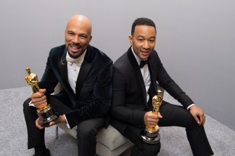 "Common and John Legend holding their Oscars for Best Original Song from the film ""Selma"""